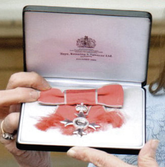 The badge of the MBE
